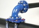 Installation of flanged saddles and bend